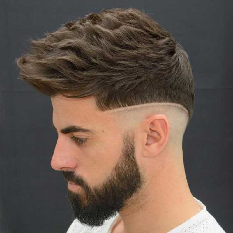 Curly Fohawk with Mid-Fade haircut