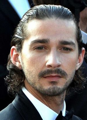 Slicked back curls hairstyle