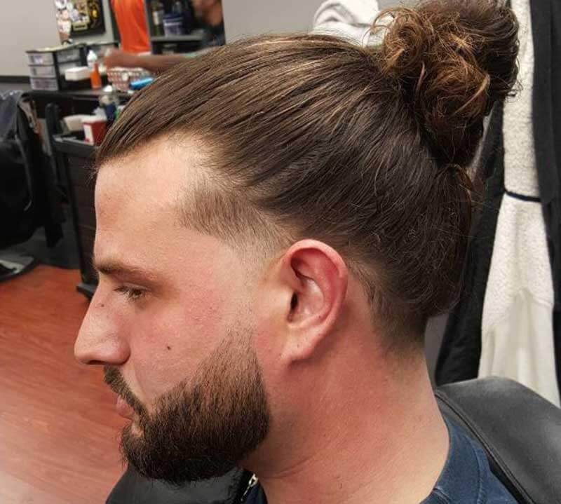 Man-bun taper hairstyle