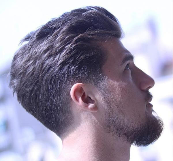 Textured Low Fade Slick Back haircut