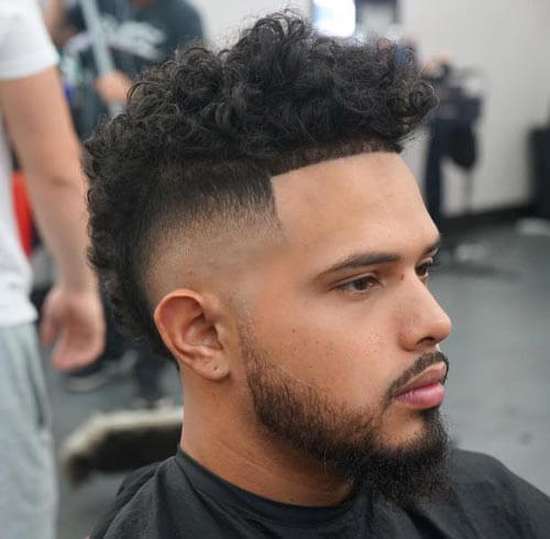 Curly Skin Fade Mohawk Haircut