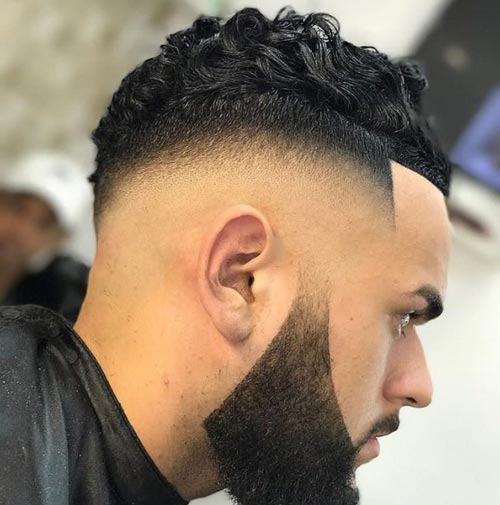 Curly Top with Skin Undercut Fade