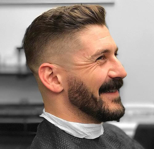 Wavy Swept Up Haircut with Undercut