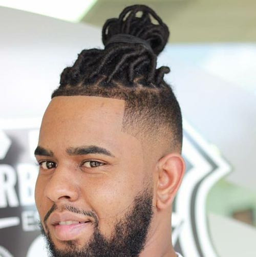 Braided Man Bun With Dread Fade