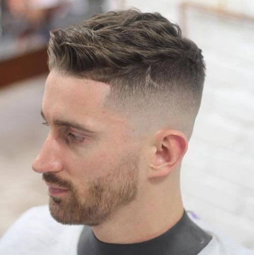 Wavy Brushed Up Haircut with Undercut