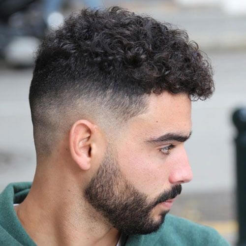 Low Fade Haircut with Loose Curls