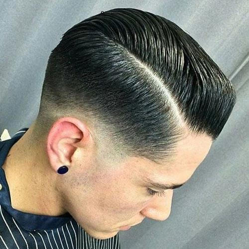 Sleeked Back Pompadour with Low Taper Fade