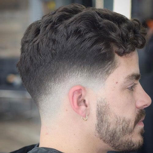 Low Fade Haircut with Wavy Fringe