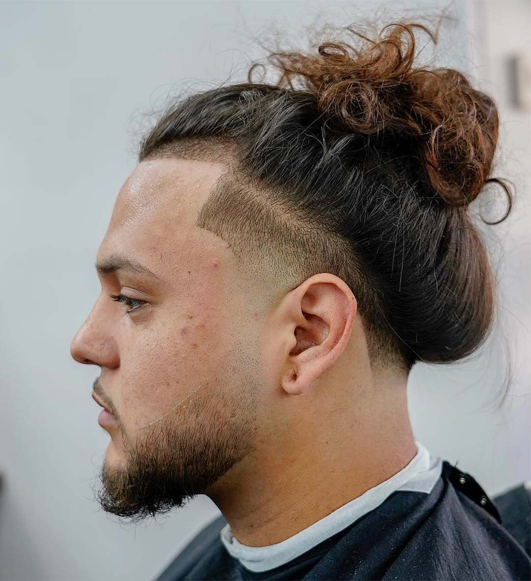 Man Bun + High Taper Fade