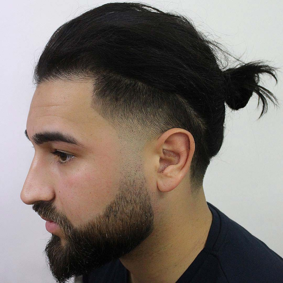 Top Knot with Mid Taper Fade